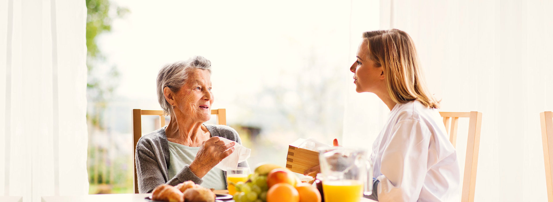 caregiver and senior woman eating