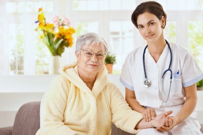 nurse and senior woman smiling in front of a camera