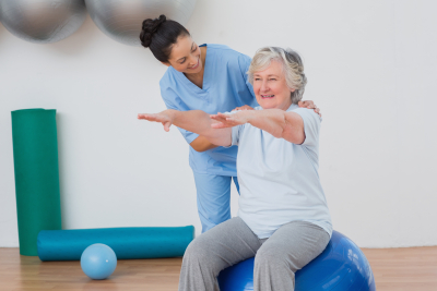 caregiver conducting physical theraphy