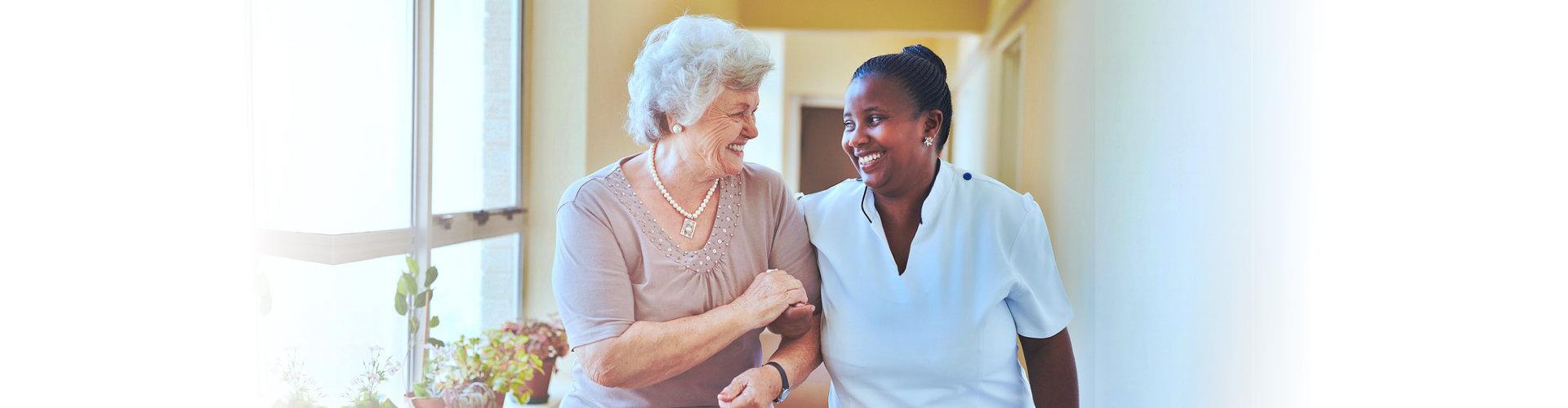 elderly talking to nurse