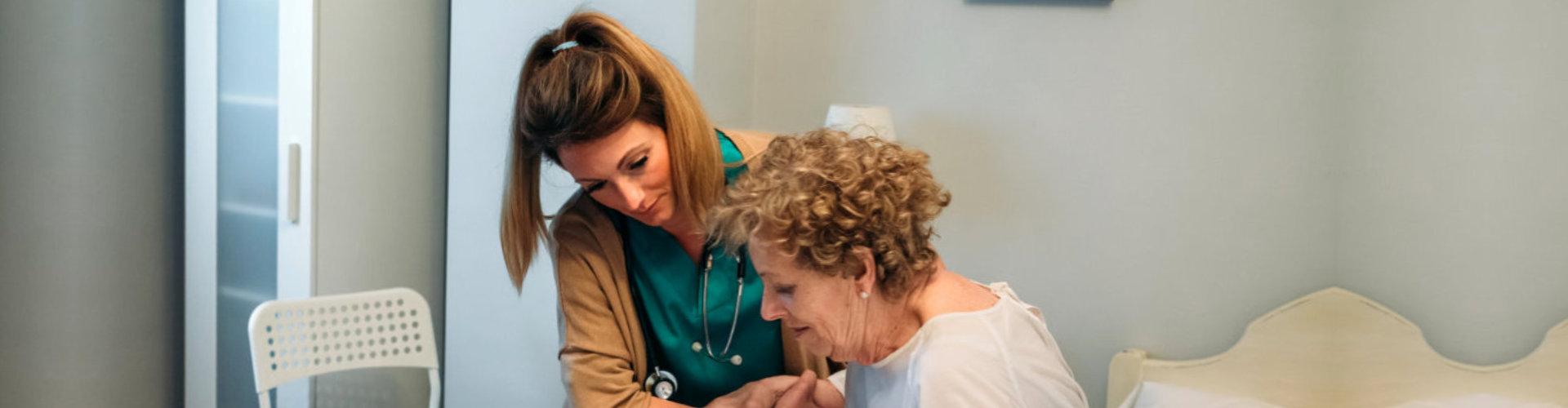 skilled nurse assiting senior woman to walk