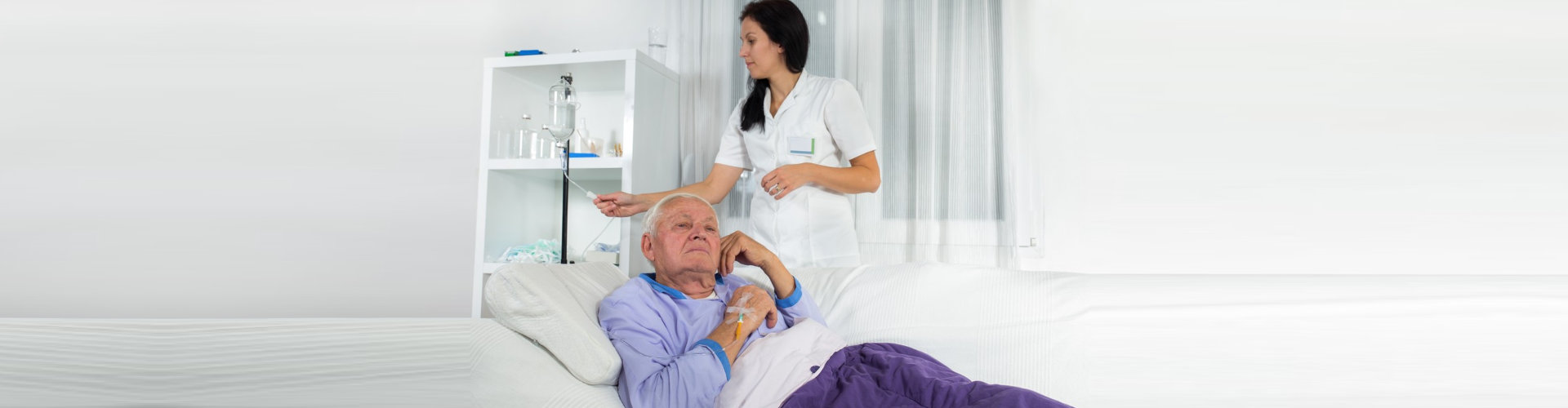 nurse checking elderly's vitals